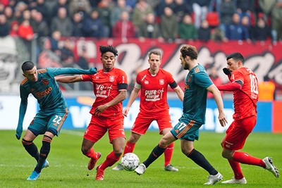 ENSCHEDE, 01-12-2019 , Stadium Grolsch Veste, season 2019 / 2020 . Dutch Eredivisie Football. Ajax players Hakim Ziyech and Daley Blind with FC Twente player Godfried Roemeratoe during the game FC Twente - Ajax 2-5.