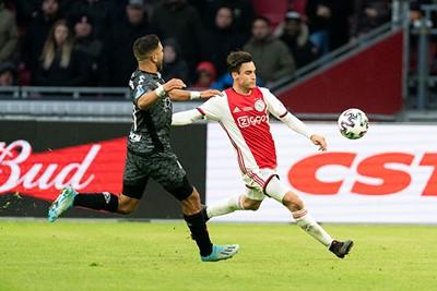 AMSTERDAM, 19-01-2020 JohanCruyff Arena , Dutch Eredivisie Football season 2019 / 2020 . Sparta player Mohamed Rayhi  and Ajax player Nico Tagliafico  during the match Ajax - Sparta Rotterdam