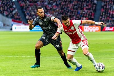 AMSTERDAM, 19-01-2020, football, Johan Cruijff ArenA, Dutch eredivisie, season 2019-2020, Sparta player Adil Aussar (L), Ajax player Dusan Tadic (R), during the match Ajax - Sparta,